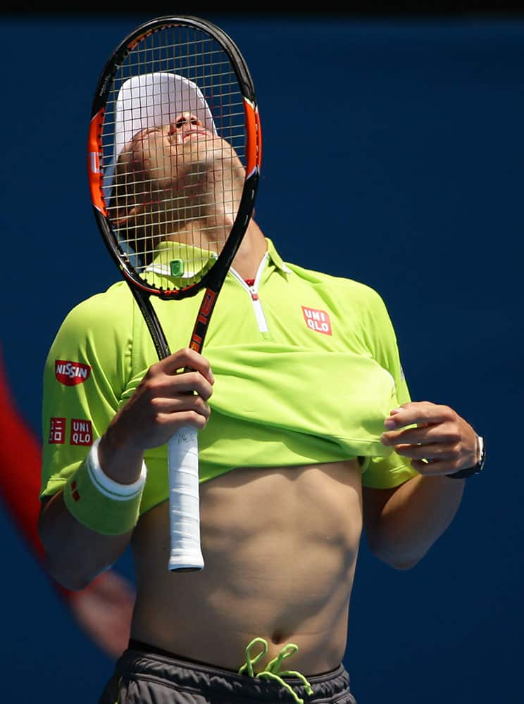 Kei Nishikori of Japan reacts to a lost point as he plays Ivan Dodig of Croatia during their second round match at the Australian Open tennis championship in Melbourne.