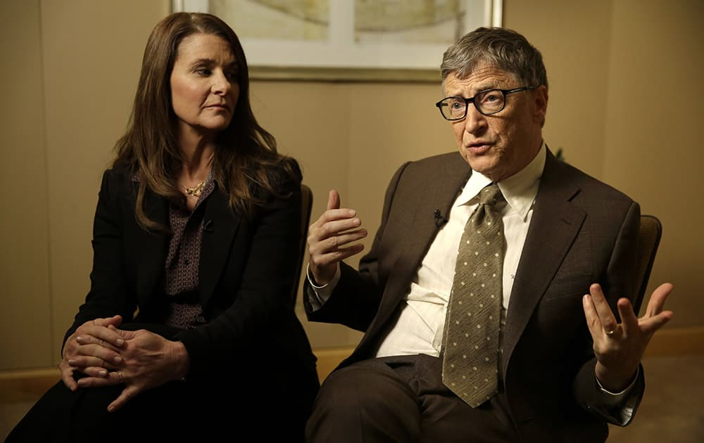 Melinda Gates listens while her husband Bill Gates talks during an interview in New York. As the world decides on the most crucial goals for the next 15 years in defeating poverty, disease and hunger, the $42 billion Gates Foundation announces its own ambitious agenda.