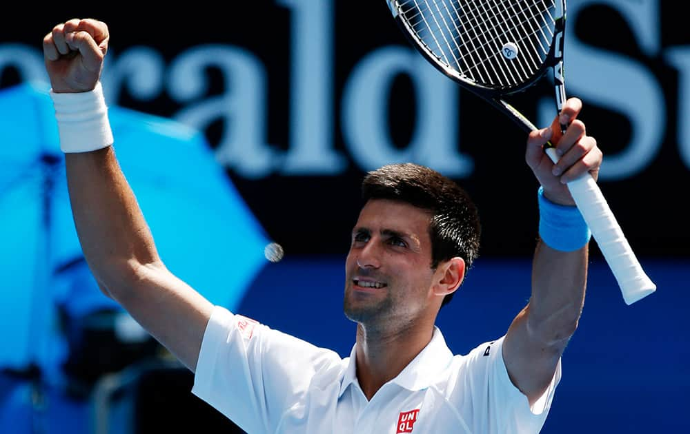 Novak Djokovic of Serbia waves to the crowd following his scone round win over Andrey Kuznetsov of Russia at the Australian Open tennis championship in Melbourne, Australia.