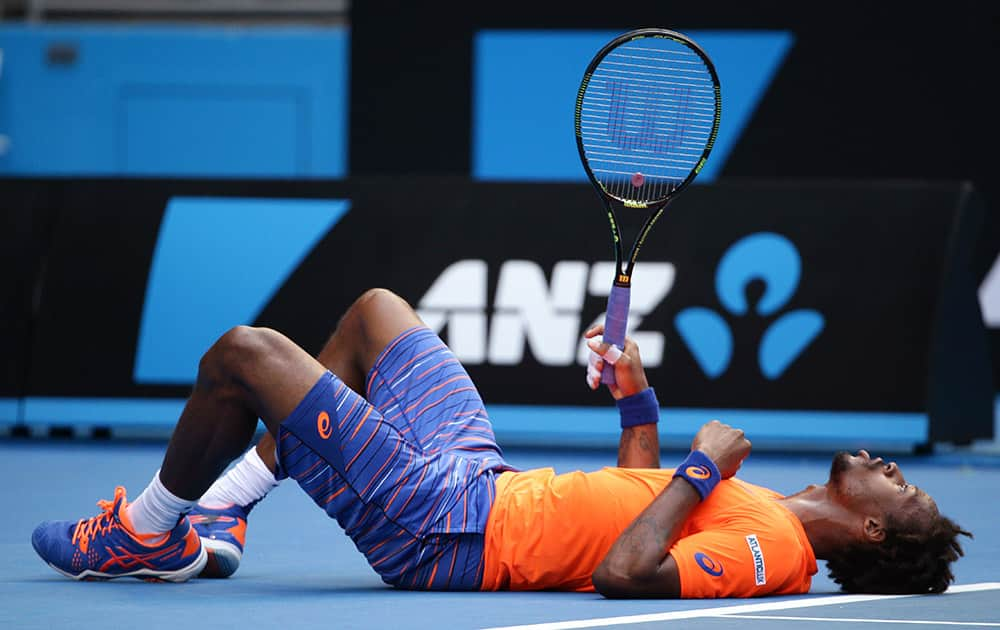 Gael Monfils of France lays on the court after he fell during his second round match against Jerzy Janowicz of Poland at the Australian Open tennis championship in Melbourne, Australia.