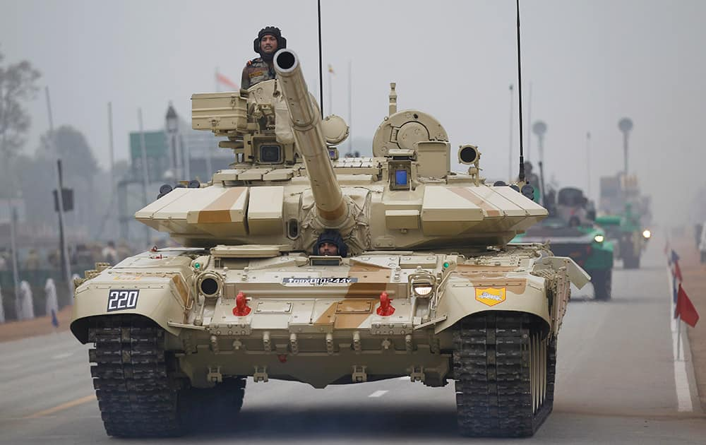 A T-90 tank rolls down Rajpath during rehearsals for the upcoming Republic Day parade in New Delhi.