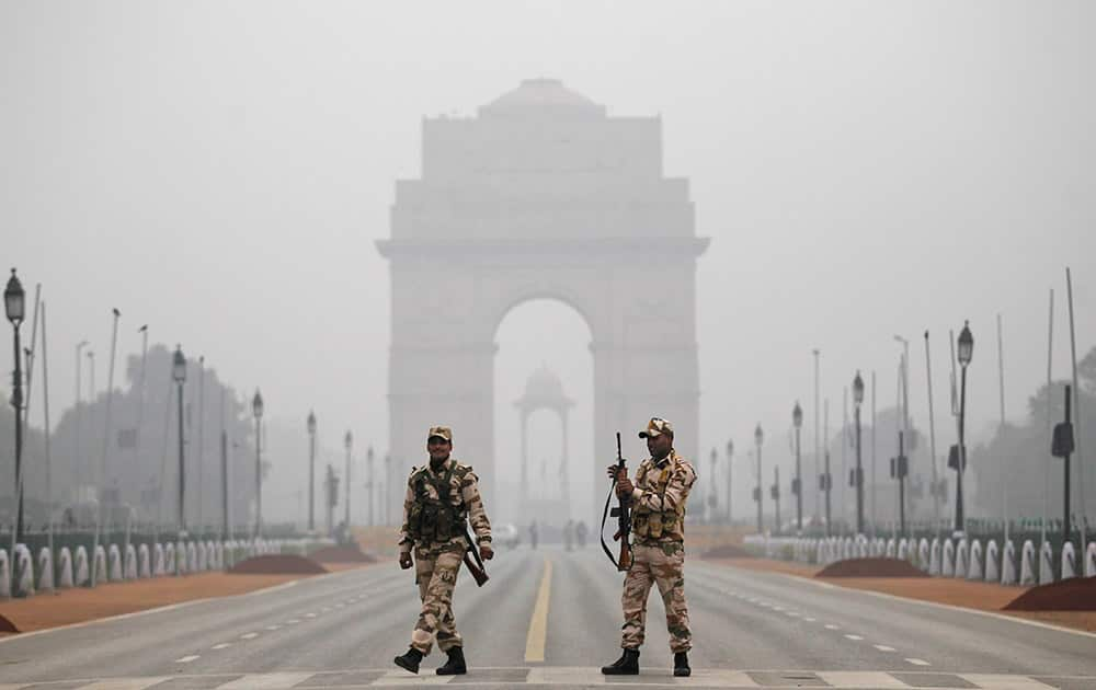 Indian paramilitary soldiers stand guard during rehearsals for the upcoming Republic Day parade in New Delhi.