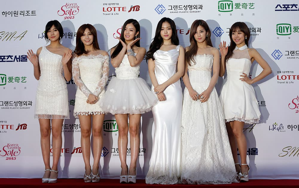 South Korean K-Pop group A Pink members pose prior to the Seoul Music Awards in Seoul, South Korea.