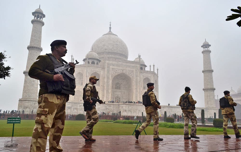 Central Industrial Security Force (CISF) personnel keep a watch on the surroundings at the Taj Mahal before US President Barack Obama's visit in Agra.