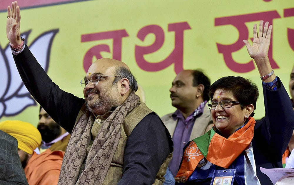 BJP President Amit Shah and partys Delhi Chief Ministerial candidate Kiran Bedi waves to partys booth in-charges at a rally in New Delhi.