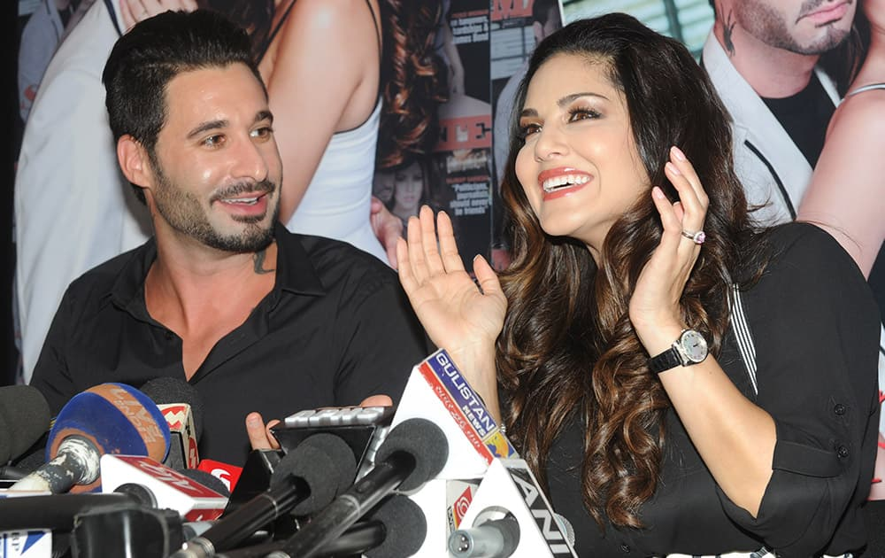 Sunny Leone and Daniel Weber during the cover launch of magazine in Mumbai. DNA