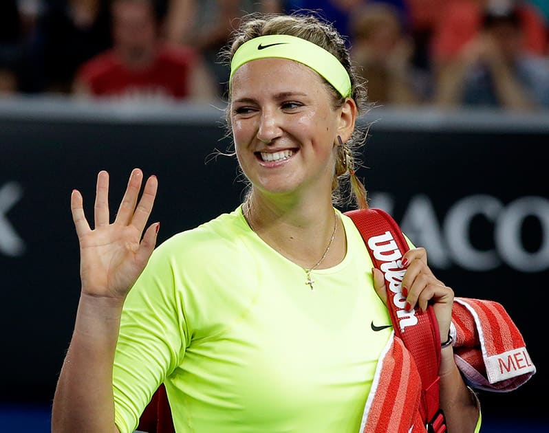 Victoria Azarenka of Belarus waves after defeating Caroline Wozniacki of Denmark in their second round match at the Australian Open tennis championship in Melbourne.