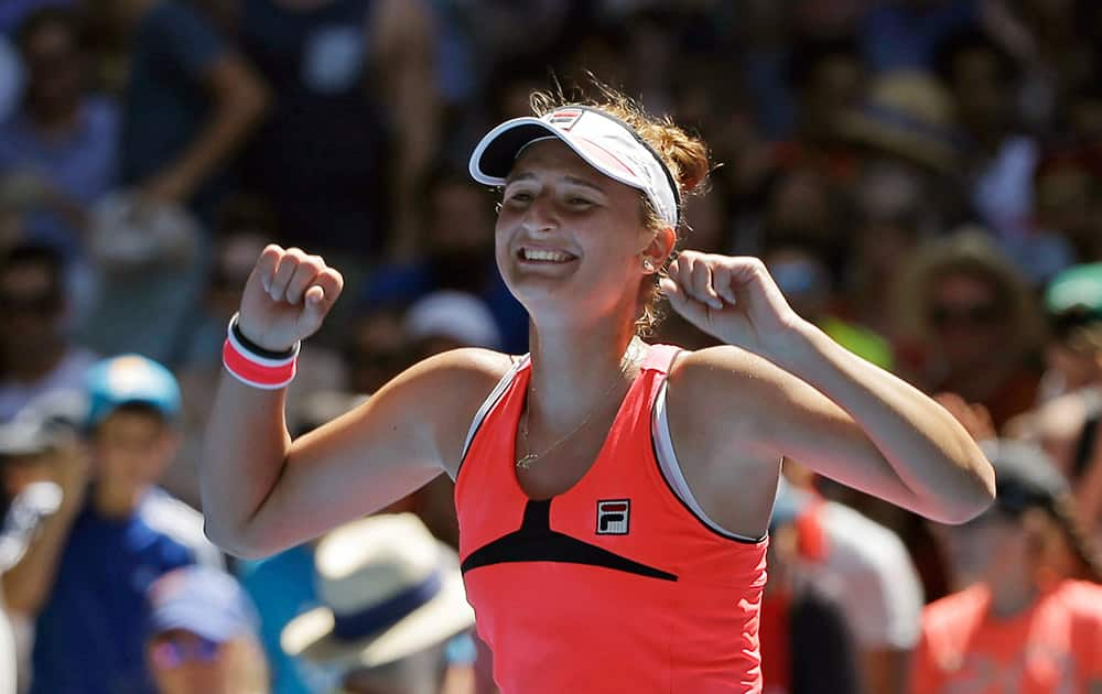 Irina-Camelia Begu of Romania celebrates after defeating Carina Witthoeft of Germany in their third round match at the Australian Open tennis championship in Melbourne.