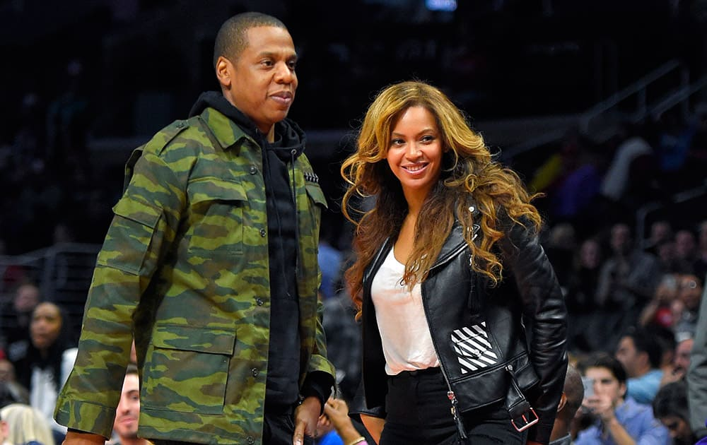 Singer Beyonce and Jay-Z leave after watching the second half of an NBA basketball game between the Los Angeles Clippers and the Brooklyn Nets.