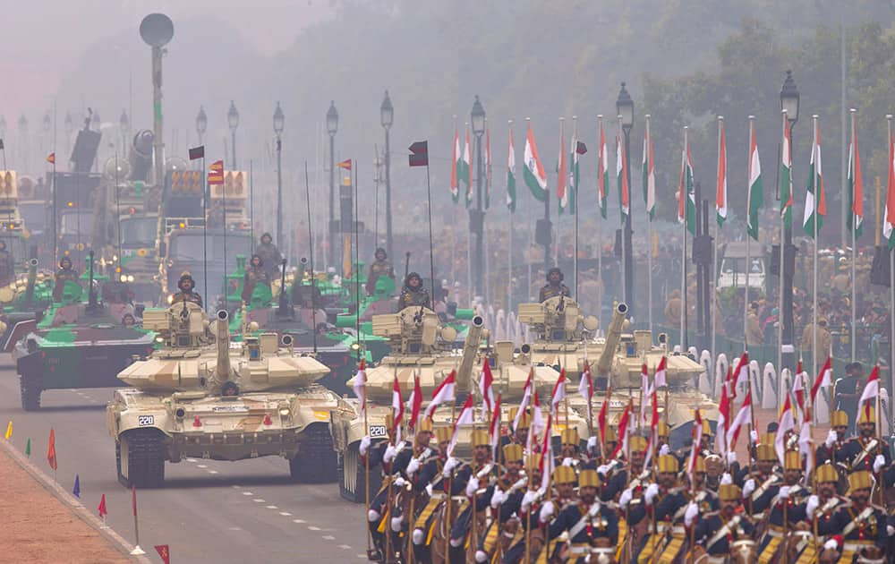 T-90 tanks roll down Rajpath, a ceremonial boulevard that runs from Indian President's palace to war memorial India Gate, as part of the full dress rehearsal ahead of Republic Day parade in New Delhi.