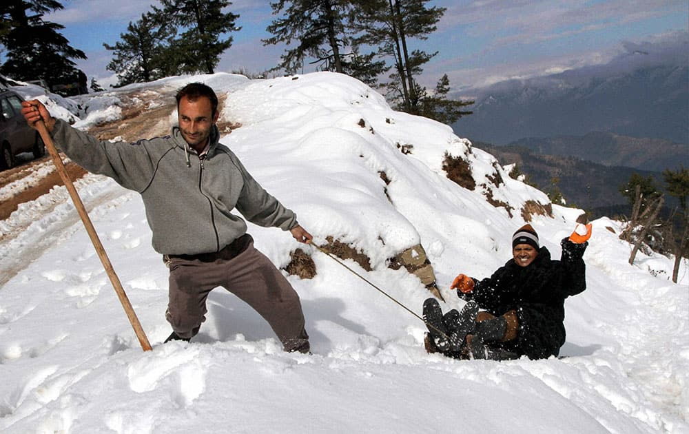 Tourists enjoying first snow fall at Nathatop about 110 KM from Jammu.