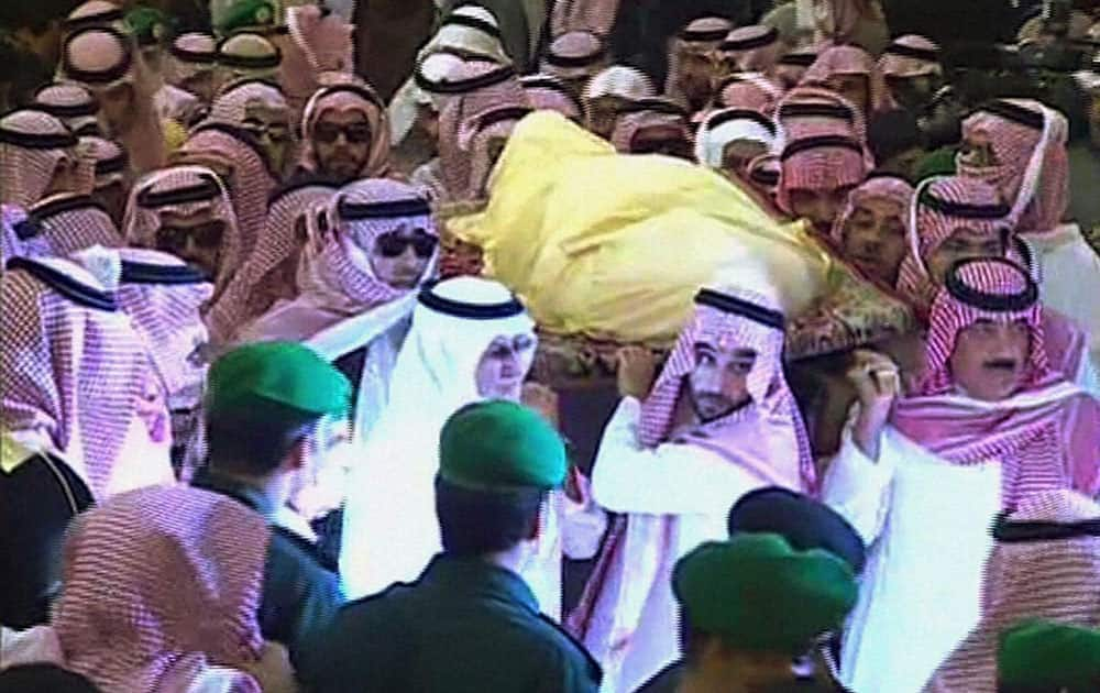 This image made from video by Saudi TV via AP video, princes of Saudi King Abdullah and mourners carry of the body of the king from the Imam Turki bin Abdullah mosque during his funeral procession in Riyadh, Saudi Arabia.