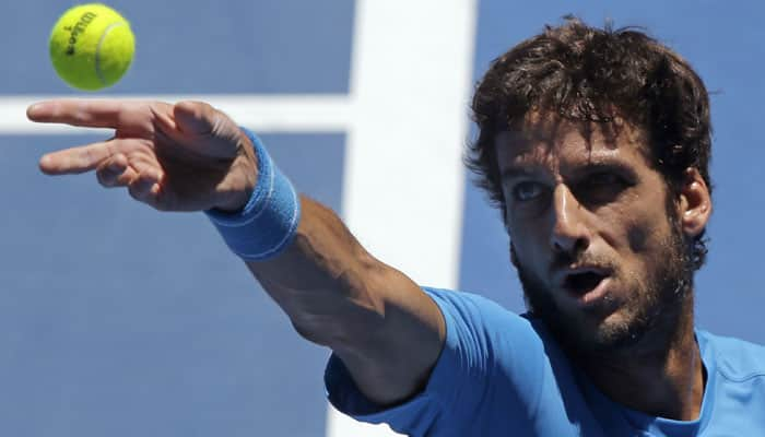 Australian Open: Feliciano Lopez apologises to injured ball-boy for low blow