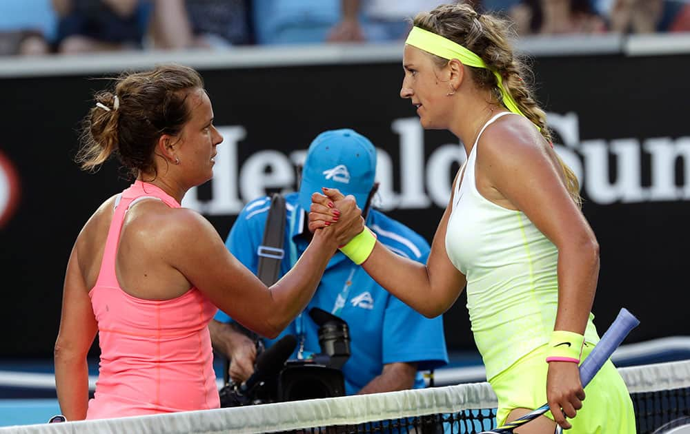 Victoria Azarenka of Belarus, right, is congratulated by Barbora Zahlavova Strycova of the Czech Republic after winning their third round match at the Australian Open tennis championship in Melbourne, Australia.