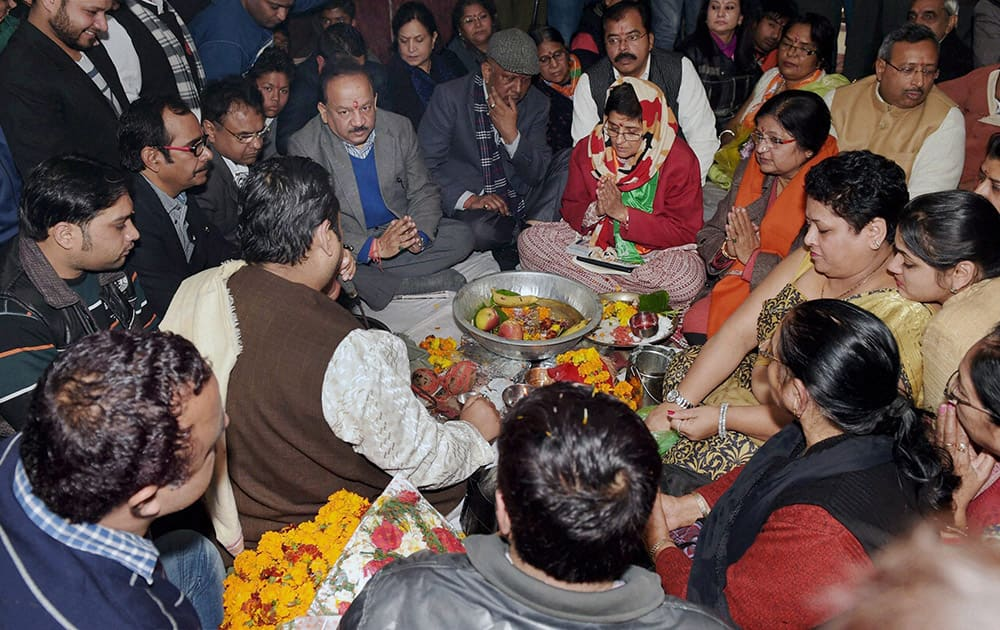 BJP Chief Ministerial candidate Kiran Bedi and Union Science and Technology Minister Harsh Vardhan offering pooja during the inauguration of election office at Krishna Nagar in New Delhi.