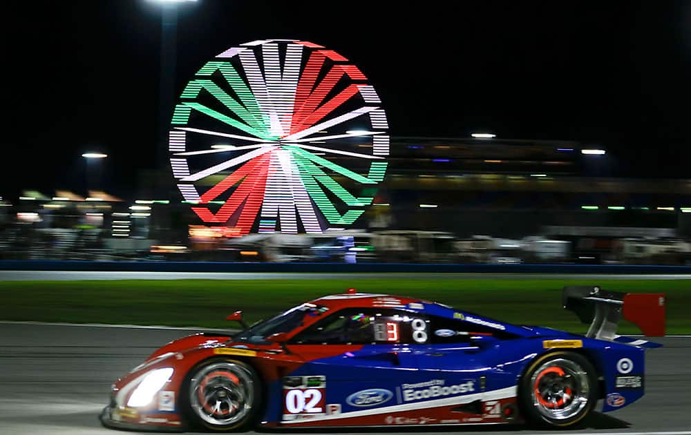 Jamie McMurray drives the Riley DP Ford during the evening at the IMSA 24 hour auto race at Daytona International Speedway, in Daytona Beach, Fla.