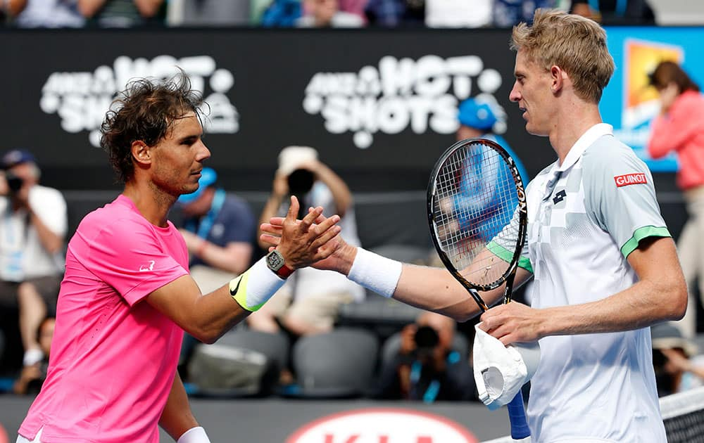 Rafael Nadal of Spain, left, shakes hands with Kevin Anderson of South Africa after winning their fourth round match at the Australian Open tennis championship in Melbourne, Australia.