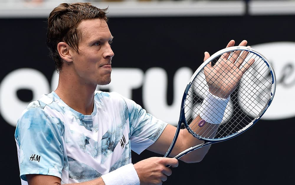 Tomas Berdych of the Czech Republic celebrates after defeating Bernard Tomic of Australia in their fourth round match at the Australian Open tennis championship in Melbourne, Australia.