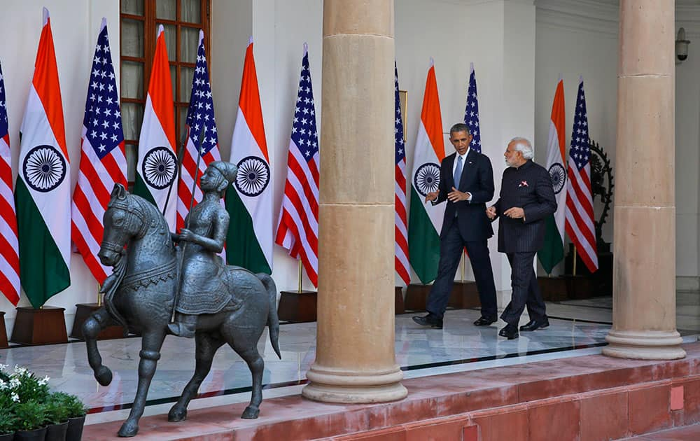 President Barack Obama and Indian Prime Minister Narendra Modi walk to attend a meeting in New Delhi, India.