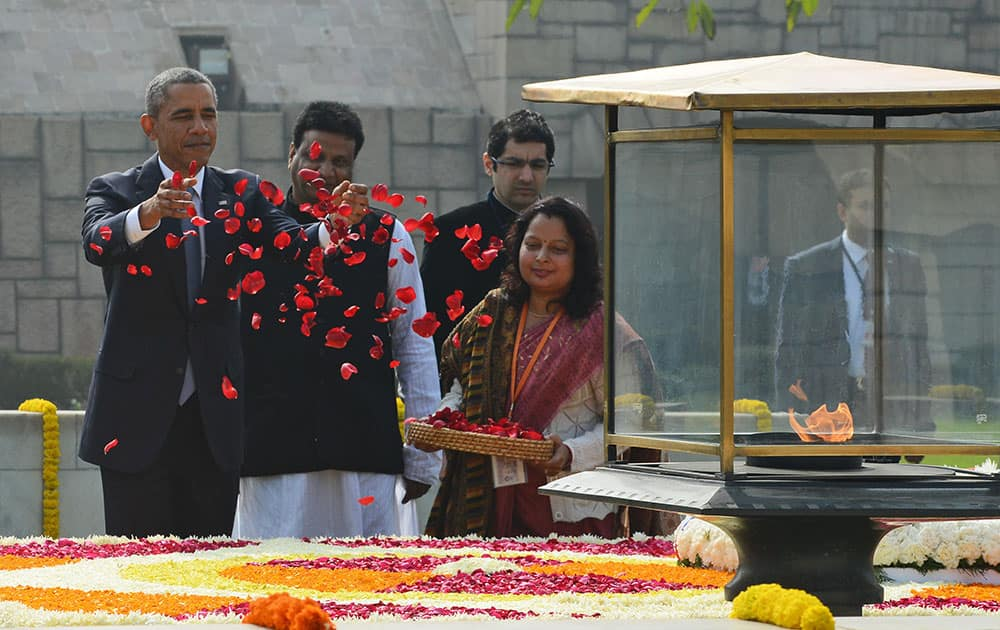 President Barack Obama offers floral tribute at the site where Indian independence icon Mahatma Gandhi was cremated in New Delhi, India.