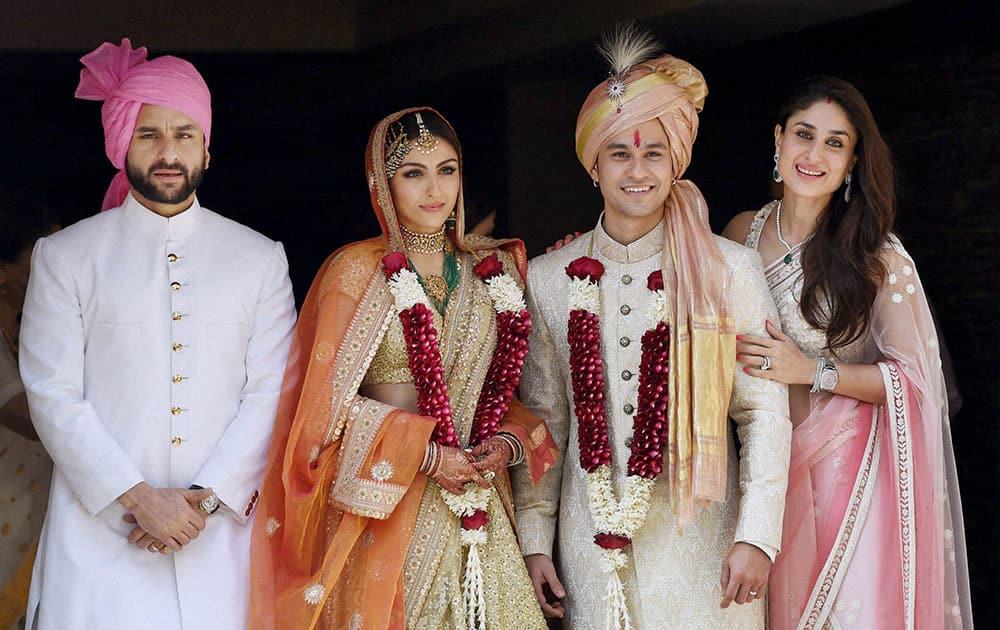 Newly-wed couple Soha Ali Khan and Kunal Khemu along with family members Saif Ali Khan and Kareena Kapoor Khan in Mumbai.