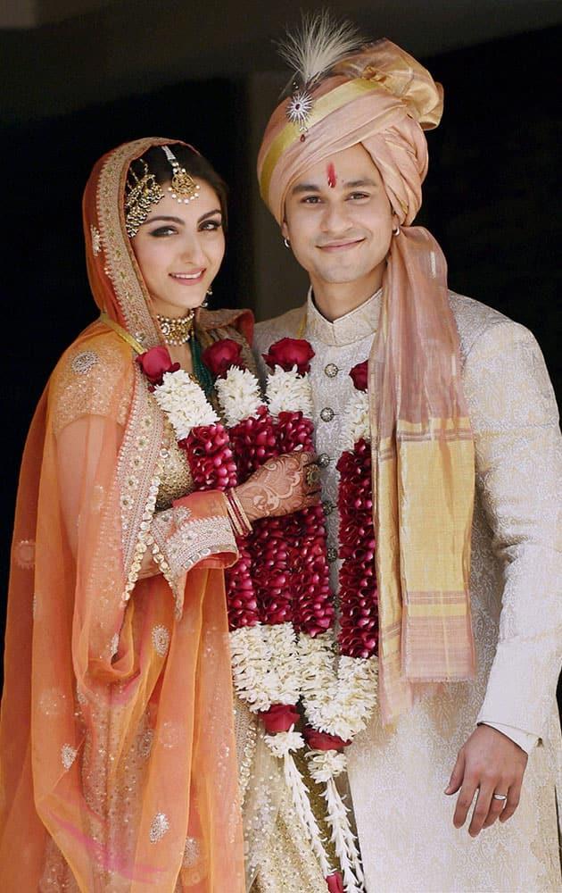 Newly-wed couple Soha Ali Khan and Kunal Khemu pose for photographs outside their residence in Mumbai on Sunday.