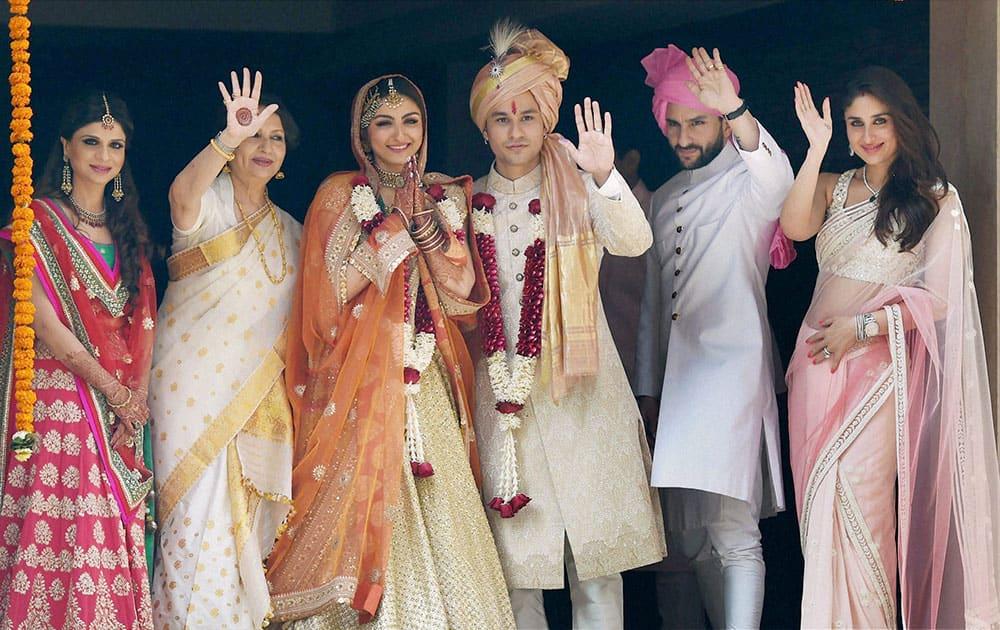 Newly-wed couple Soha Ali Khan and Kunal Khemu along with family members Sabah Ali Khan, Sharmila Tagore, Saif Ali Khan and Kareena Kapoor Khan stand outside their residence in Mumbai.