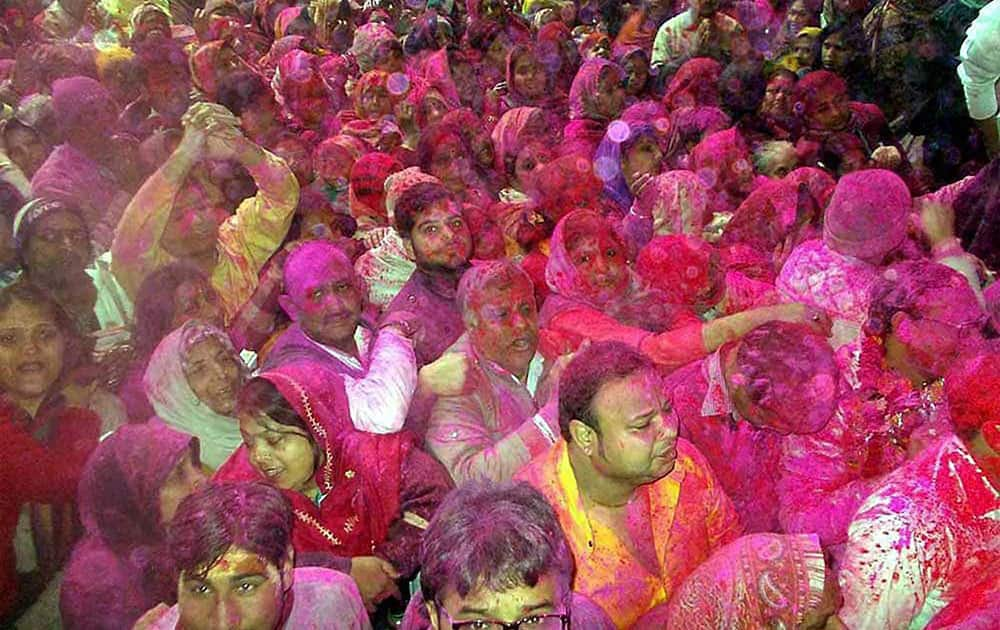 Devotees smeared in colours during the Holi festival started in Bankey Bihari temple, Vrindavan on the occasion of Basant Panchmi in Mathura..