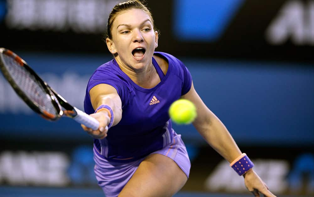 Simona Halep of Romania makes a forehand return to Yanina Wickmayer of Belgium during their fourth round match at the Australian Open tennis championship.