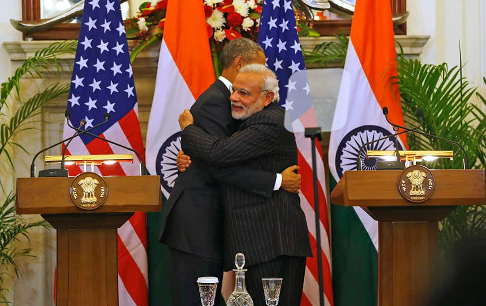 US President Barack Obama, and Indian Prime Minister Narendra Modi hug after they jointly addressed the media after their talks, in New Delhi, India, Sunday.