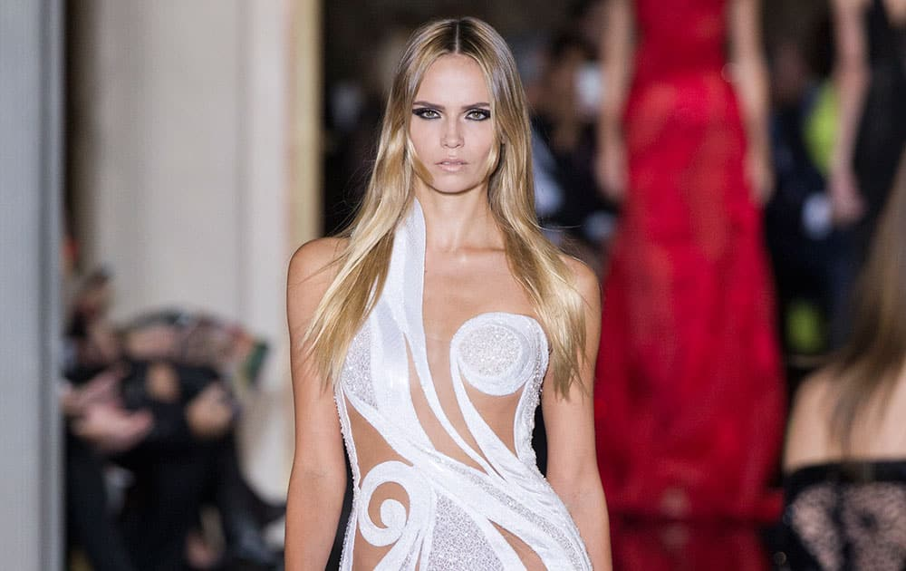 A model presents a creation by Italian fashion designer Donatella Versace, as part of the Atelier Versace Spring Summer 2015-16 Haute Couture fashion collection in Paris.