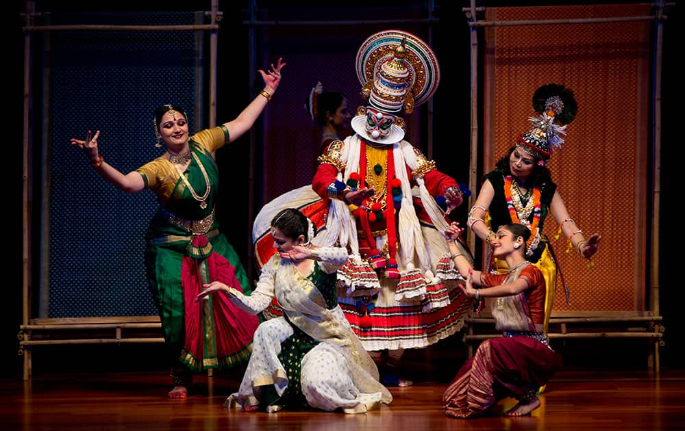 Performers are seen on stage during a cultural performance for US President Barack Obama and first lady Michelle Obama, before a State Dinner at the Rashtrapati Bhavan, the presidential palace, in New Delhi.