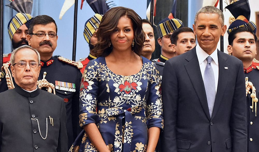 US President Barack Obama, winks standing beside first lady Michelle Obama and President Pranab Mukherjee during a receiving line before State Dinner at the Rashtrapati Bhavan, the presidential palace, in New Delhi.