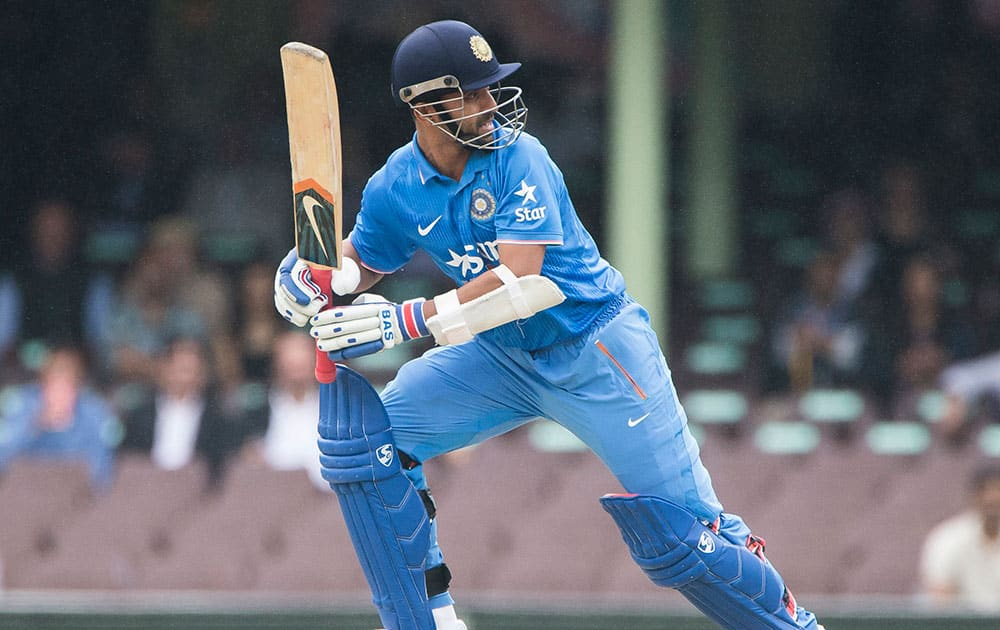 Ajinkya Rahane hits a ball to the boundary for 4 during their one day international cricket match in Sydney.