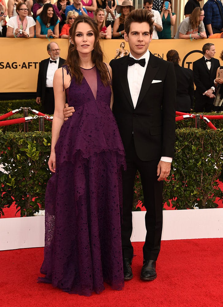 Keira Knightley, left, and James Righton arrive at the 21st annual Screen Actors Guild Awards at the Shrine Auditorium, in Los Angeles.