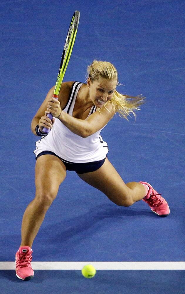 Dominika Cibulkova of Slovakia plays a shot to Victoria Azarenka of Belarus during their fourth round match at the Australian Open tennis championship in Melbourne, Australia.