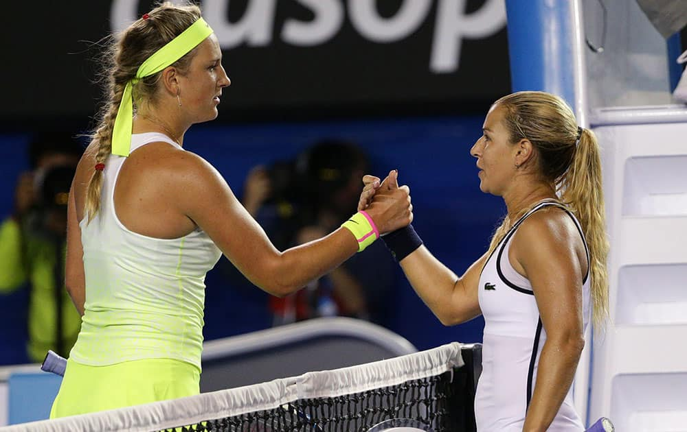 Dominika Cibulkova of Slovakia, right, shakes hands with Victoria Azarenka of Belarus after winning their fourth round match at the Australian Open tennis championship in Melbourne, Australia.