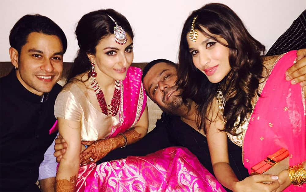 Soulmates, best friends and now husband & wife..Love at its best! Stay blessed @sakpataudi @kunalkemmu - twitter @Sophie_Choudry