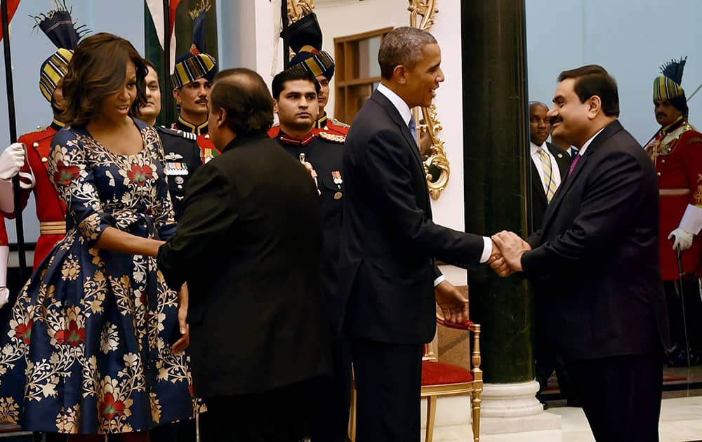 US President Barack Obama and First Lady Michelle Obama meeting industrialists Mukesh Ambani and Gautam Adani during a banquet hosted at the Rashtrapati Bhavan in New Delhi.