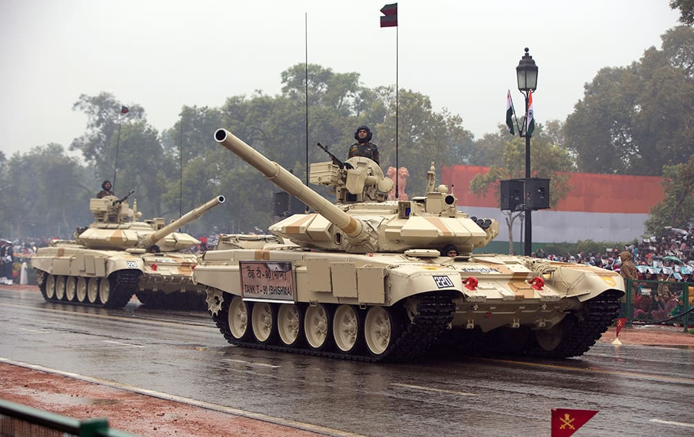 Tanks move along the Republic Day Parade route in New Delhi. President Barack Obama is the Chief Guest for this year's parade.