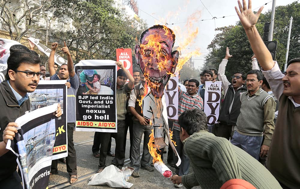 Members of All India Democratic Students Organization burn an effigy of US President Barack Obama as they protest against his visit to India, in Kolkata.