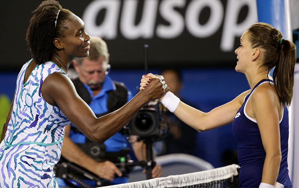 Venus Williams of the U.S., left, shakes hands with Agnieszka Radwanska of Poland after winning their fourth round match at the Australian Open tennis championship in Melbourne, Australia, Monday.