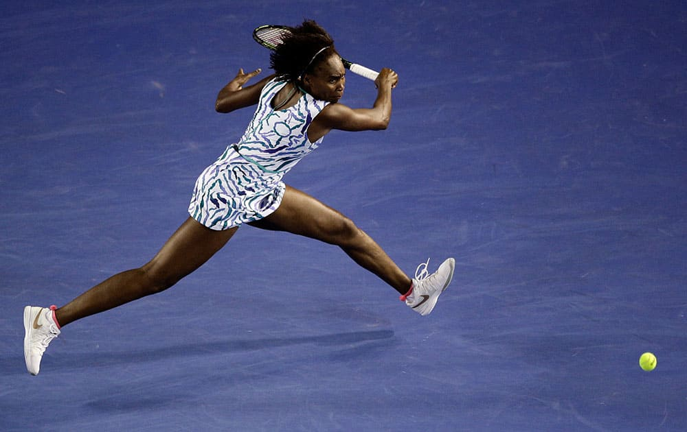 Venus Williams of the U.S. chases down a shot to Agnieszka Radwanska of Poland during their fourth round match at the Australian Open tennis championship in Melbourne, Australia, Monday.