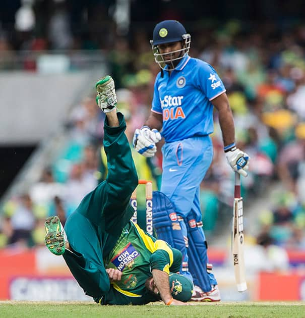 Australian Glen Maxwell goes for a tumble in an attempt to run out Ambati Rayudu during their one day international cricket match in Sydney.