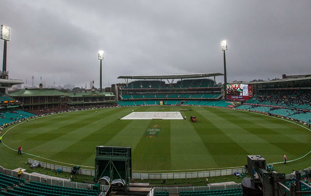 Rain delays play with India at 2 for 69 during their one day international cricket match in Sydney.