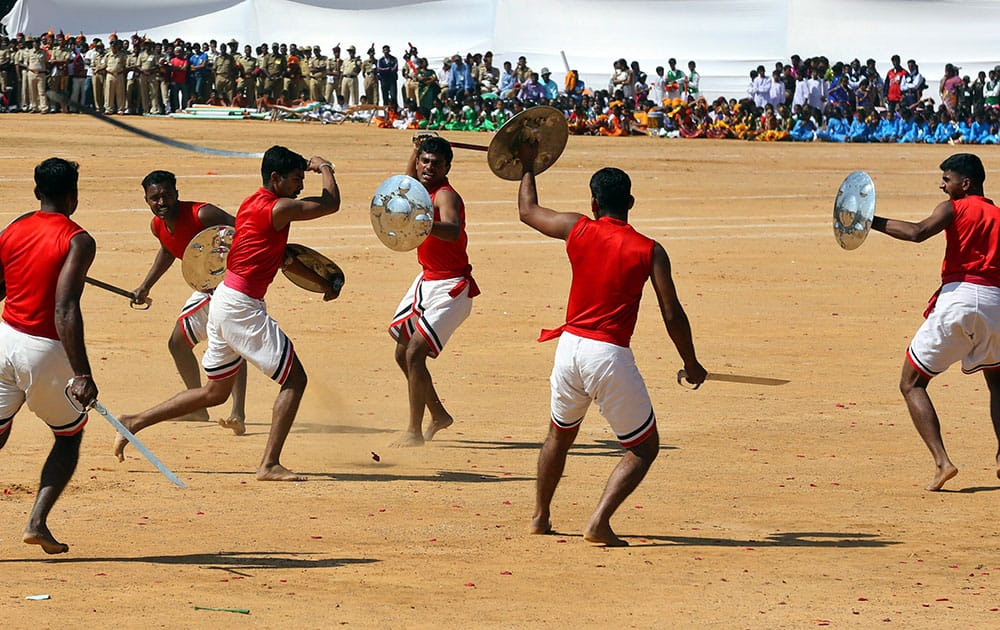 Indian Army soldiers perform Kalaripayattu, a traditional Indian martial art, during Republic Day celebrations in Bangalore, India, Monday.