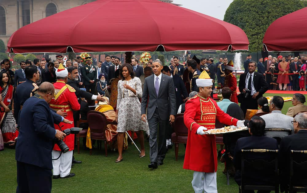 US President Barack Obama, along with first lady Michelle Obama arrives for a photo op during a reception hosted by President Pranab Mukherjee on India's Republic Day at the presidential palace in New Delhi.
