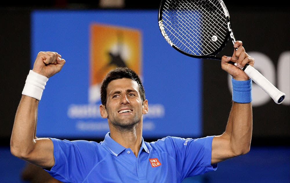 Novak Djokovic of Serbia celebrates after defeating Gilles Muller of Luxembourg in their fourth round match at the Australian Open tennis championship in Melbourne, Australia.