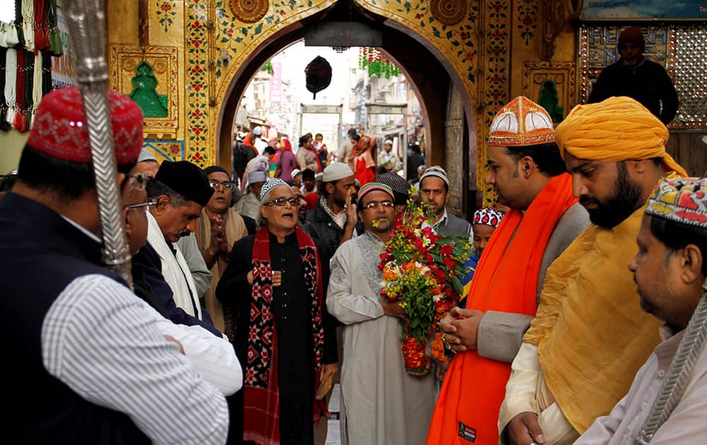 Priests and Shahi Quwaal participate in a royal procession at the shrine of Sufi Saint Khwaja Moinuddin Chishti in Ajmer.
