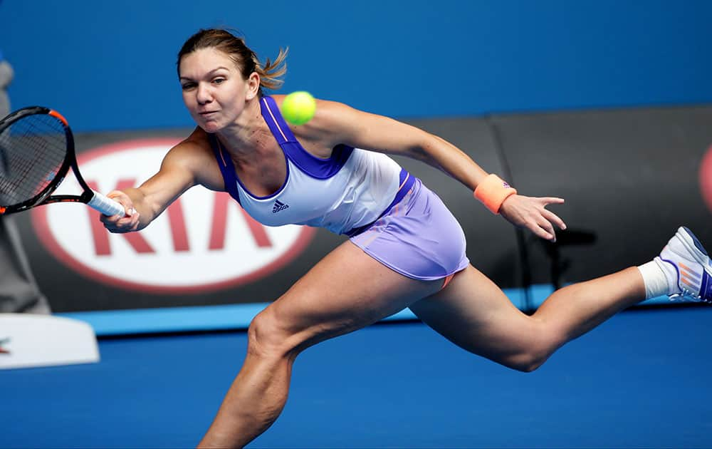 imona Halep of Romania reaches for a shot to Ekaterina Makarova of Russia during their quarterfinal match at the Australian Open tennis championship.